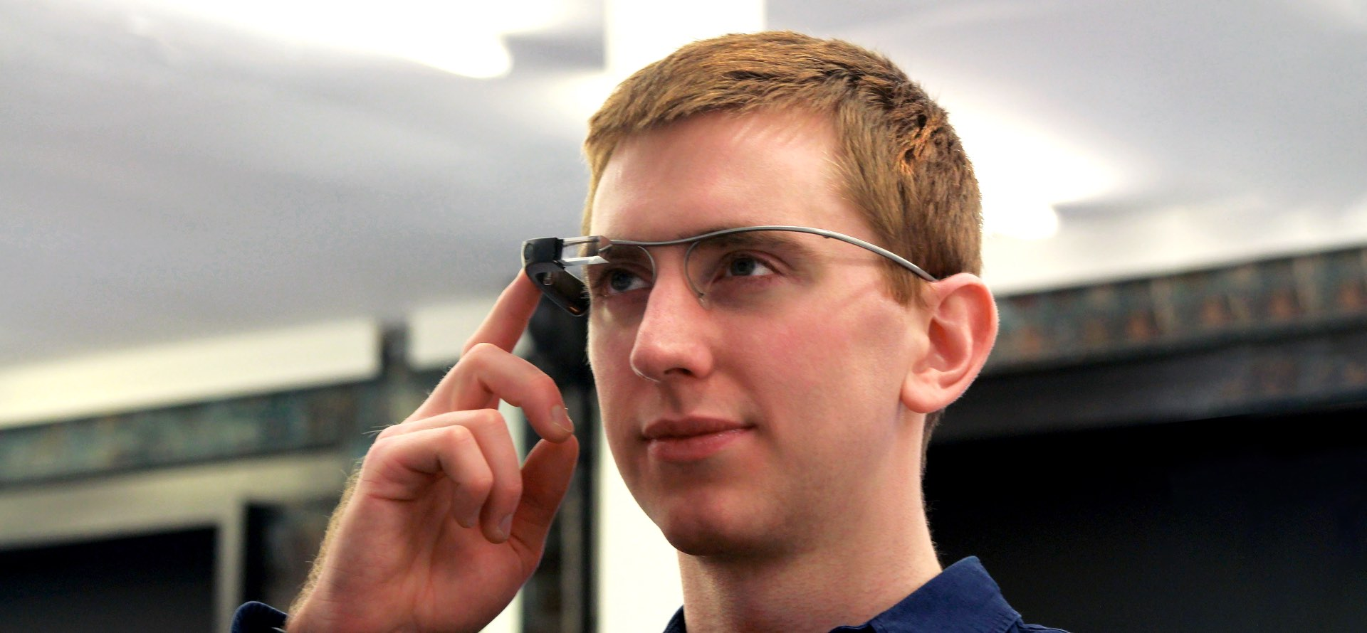 Close up image of a man's face wearing google glass