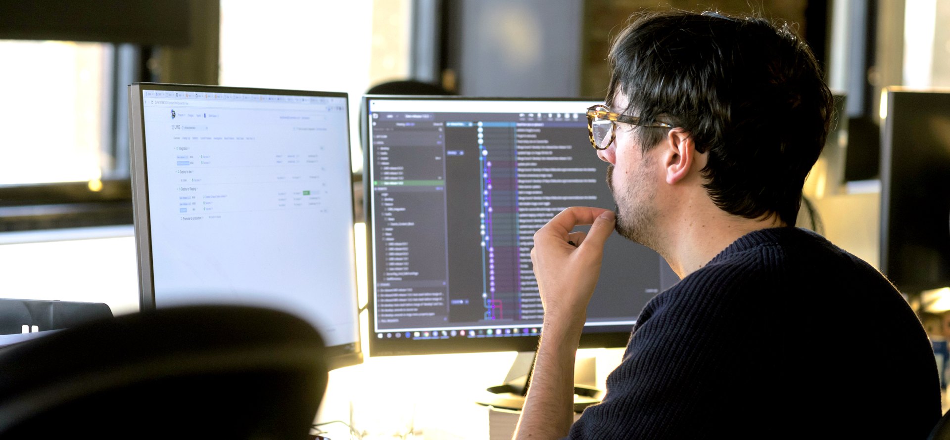 image of a man looking at code on a computer