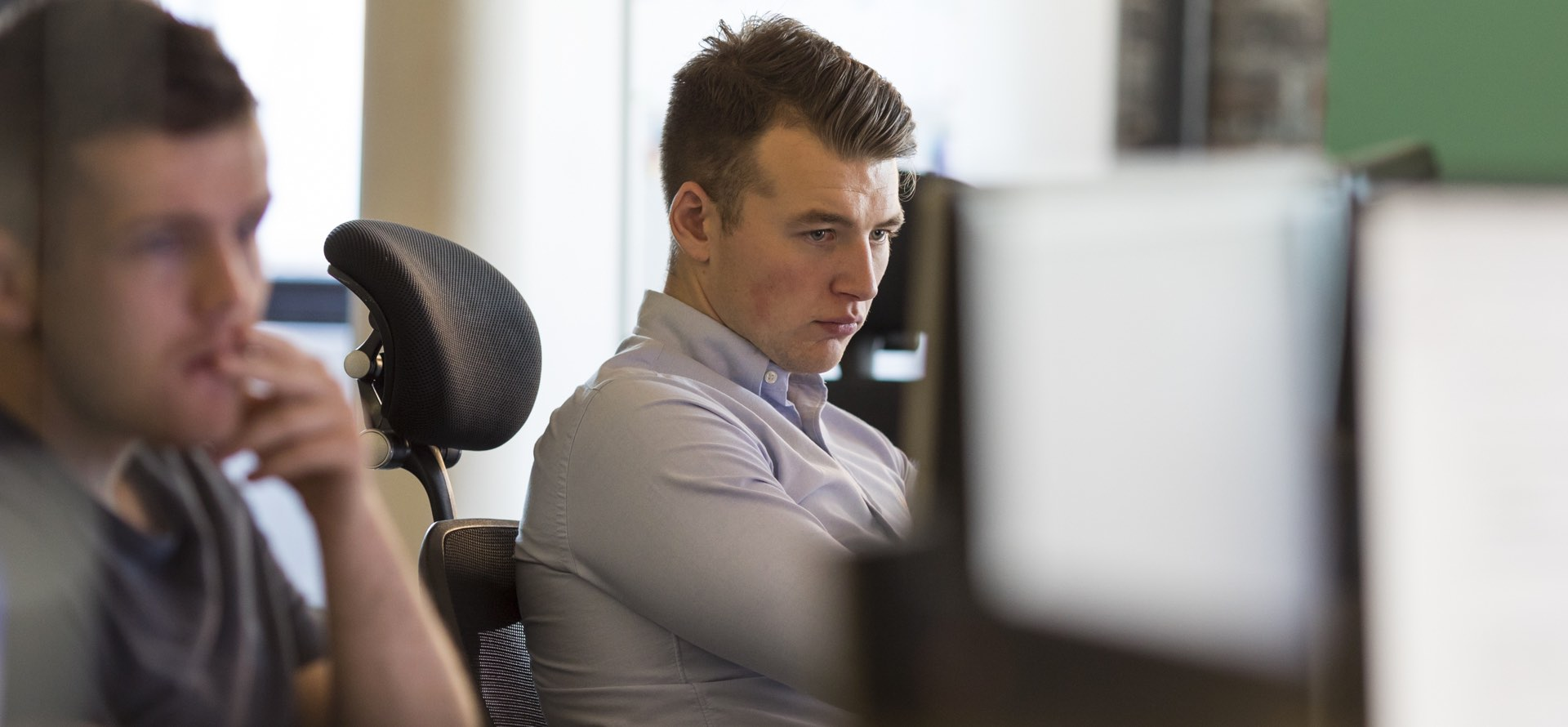 Image of a developer working at his desk
