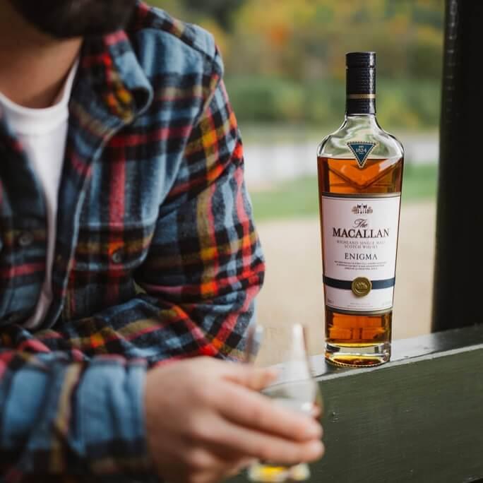 Bottles of Jim Beam, Macallan 12 year old whisky, Suntory whisky