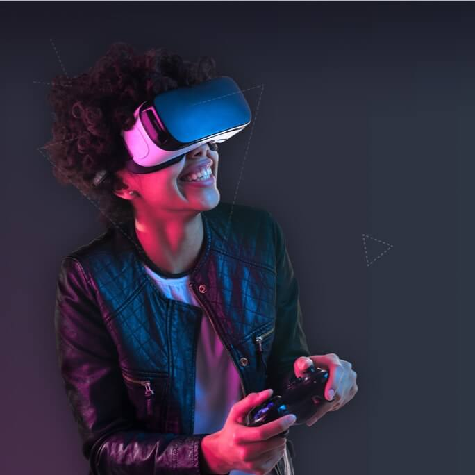 A female student smiling while playing a game on a VR headset